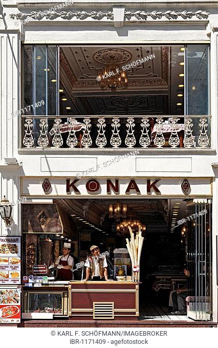Beautiful old cafe with street sale of ice cream, labeled Konak, hostel, shopping street, Istiklal Caddesi, Beyoglu, Istanbul, Turkey