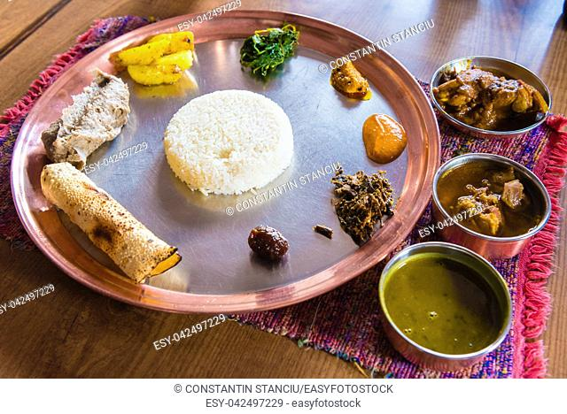 Top view over Dal bhat plate, a traditional meal from the Indian subcontinent, popular in many areas of Nepal, Bangladesh and India