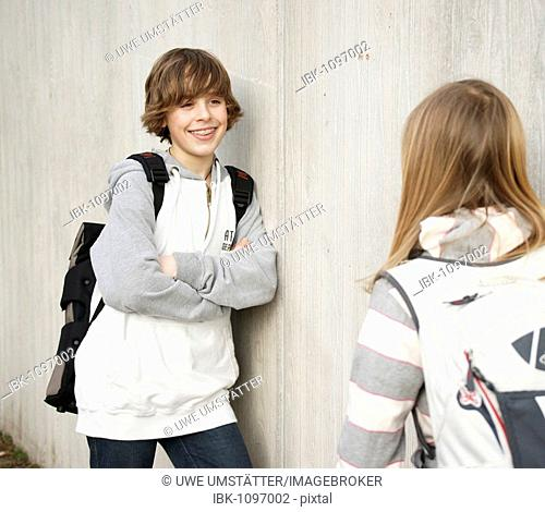 Boy and a girl talking in the schoolyard