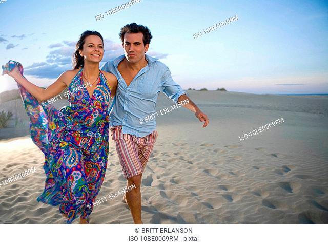 Loving couple run at beach