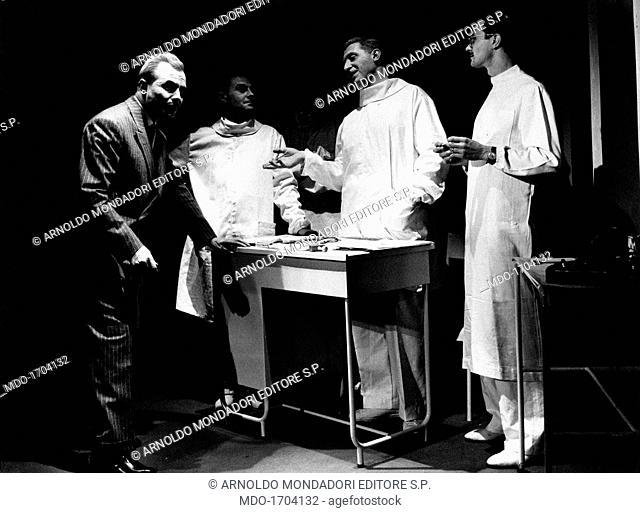 Tino Carraro with Marcello Moretti, Romolo Valli and Ferruccio De Ceresa in Un caso clinico. Italian actor Tino Carraro, born Agostino Carraro