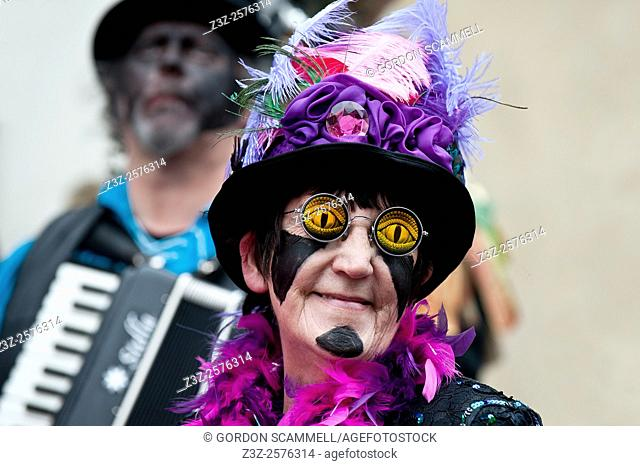 A member of the Black Pig Border Morris wears novelty sunglasses at the Sweeps Festival in Rochester Kent