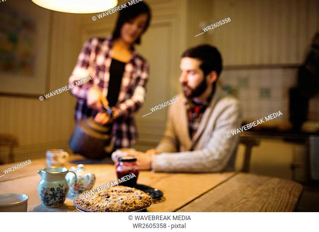 Close-up of cookie on a table with couple on background
