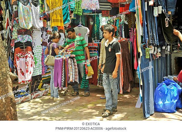 People buying clothes at a street market, Mumbai, Maharashtra, India