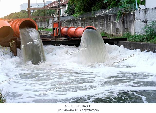 Drainage pipe with water flowing into the river
