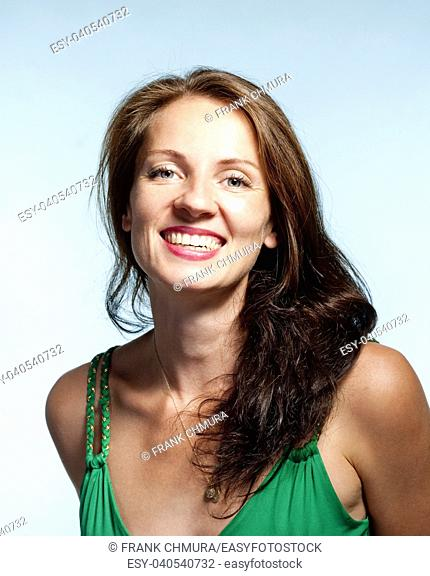 Portrait of a Middle-aged Woman with Brown Hair Smiling