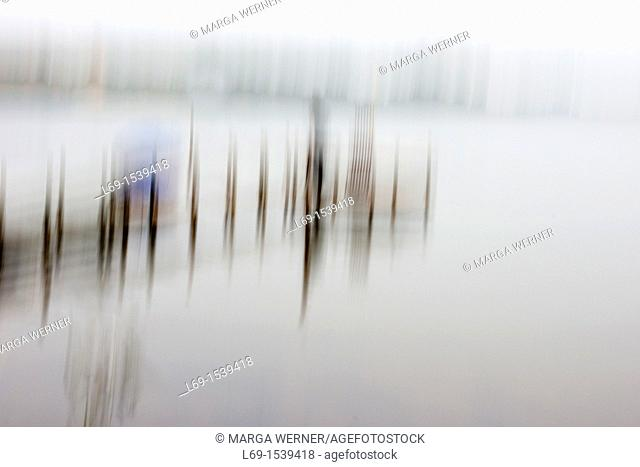 Wooden pier on al lake, abstract