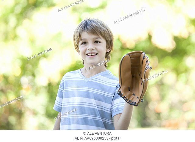 Boy wearing baseball glove
