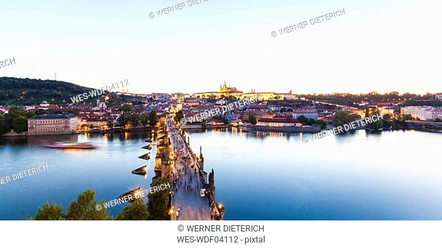 Czech Republic, Prague, cityscape with Hradcany, Charles Bridge and tourboat on Vltava