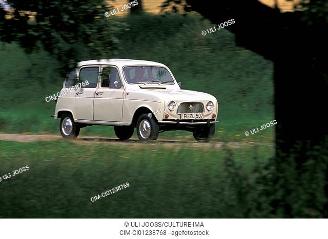 Car, Renault 4, model year 1961-1992, this car approx. model year 1963, white, vintage car, 1960s, sixties, sedan, driving, diagonal front, front view