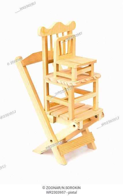 Stacked toy wooden chairs