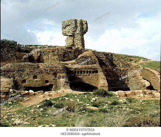Celtiberian Roman rock city of Tiermes, detail of the rock digged houses, with the Roman baths at?