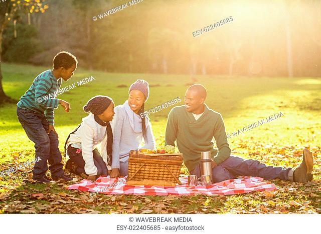 Young smiling family doing a picnic