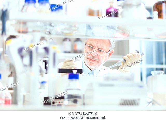 Life scientist researching in laboratory. Life sciences study living organisms on the level of microorganisms, viruses, human, animal and plant cells, genes