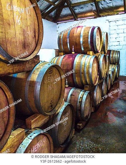 Wine maturing in barrels in a wine cellar. A wine Estate in the Western Cape Province, South Africa