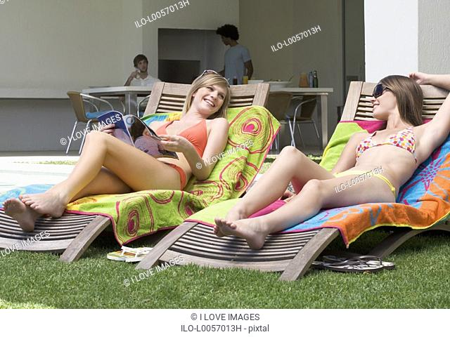 Two teenage girls sunbathing