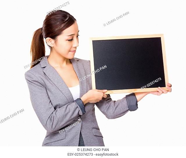 Businesswoman hold with black board