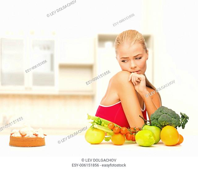 fitness, diet, health and food concept - doubting woman with fruits and pie