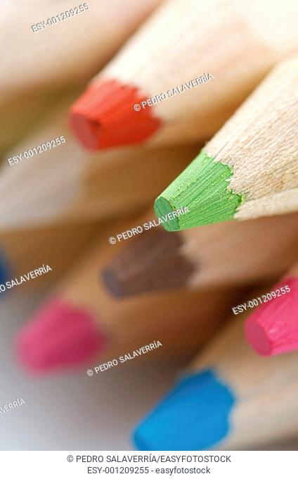 forefront of a group of colored pencils stacked