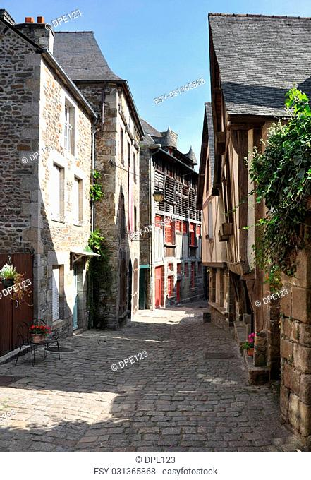 Medieval buildings in the ancient french town of Dinan in Brittany. These old houses are in the Rue du Petit Port which leads to the River Rance and port area...