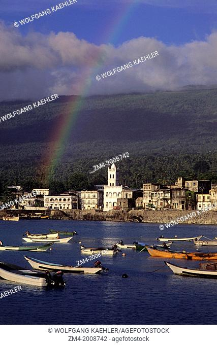 COMORO ISLANDS, GRAND COMORE, MORONI, VIEW OF TOWN WITH FISHING BOATS IN FOREGROUND, RAINBOW