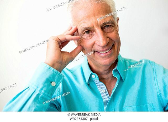 Smiling senior man looking at camera