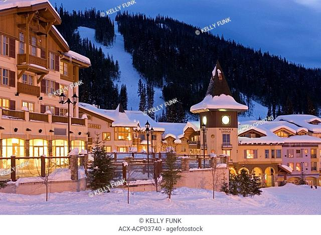 Sun Peaks Ski Resort's Village becomes aglow with lights as darkness falls, British Columbia, Canada