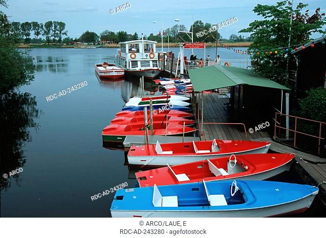 Paddleboats at landing stage Friedrichstadt North Frisia Schleswig-Holstein Germany