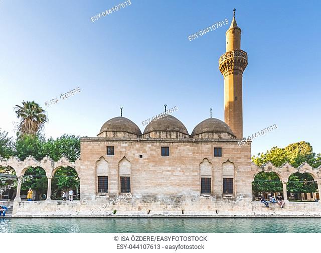 View of Rizvaniye Medresesi(Madrasah) and Balikli Gol(fish lake) in Sanliurfa city center. Sanliurfa,Turkey. 18 July 2018