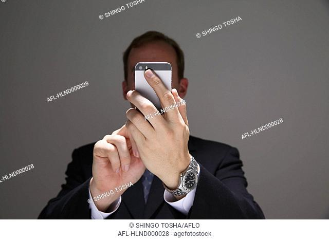 Businessman in a suit with smartphone