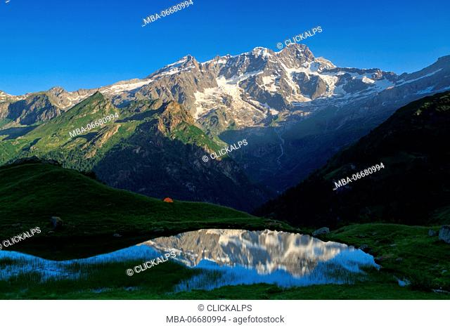 Monte Rosa reflecting in the Alpe Campo Lake,valle d'Aosta, Italy
