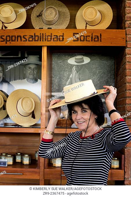 Woman tries on a hat at Emiliana Organic Winery in Casablanca Valley, Chile, South America
