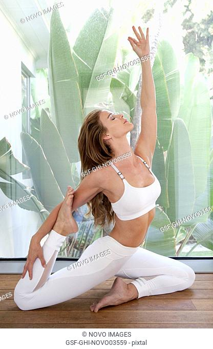 Mid-Adult Woman in Yoga Pose, Indoor