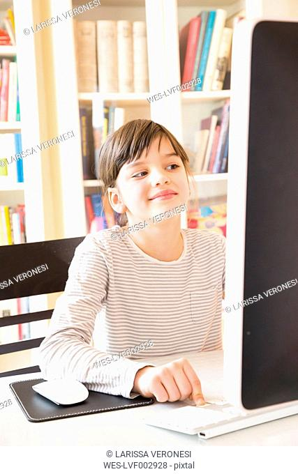 Portrait of smiling girl spending time at computer