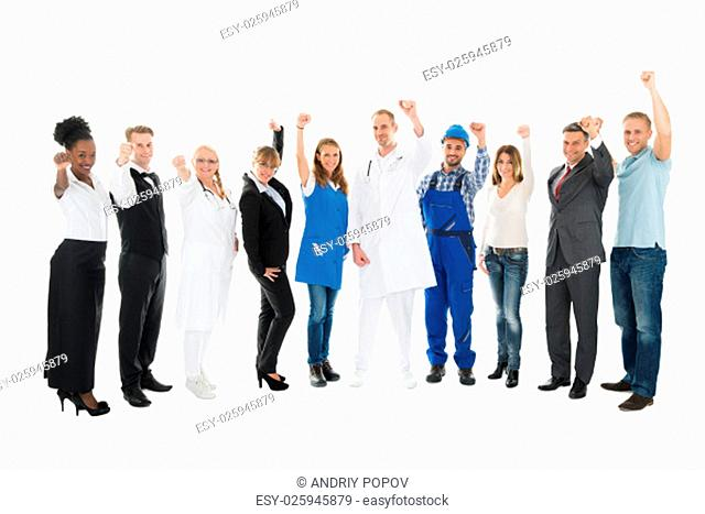 Full length portrait of people with various occupations cheering against white background