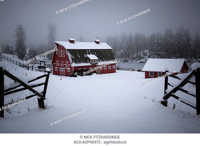 A red barn in winter, British Columbia, Canada