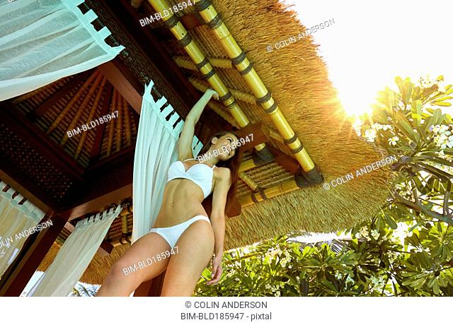 Pacific Islander woman standing in cabana
