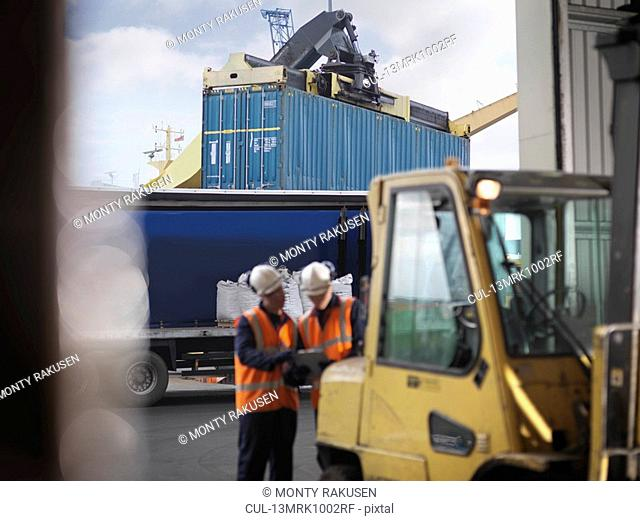 Port Workers With Shipping Container