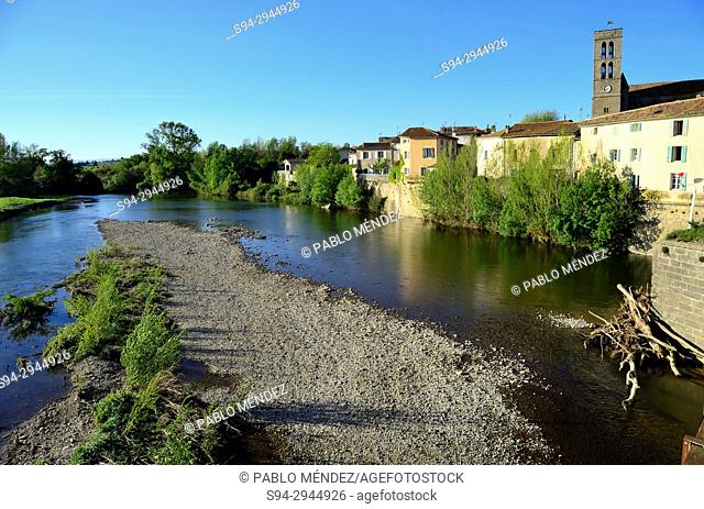 L'Aude river and tower of the church in Trebes, Languedoc-Roussillon, France
