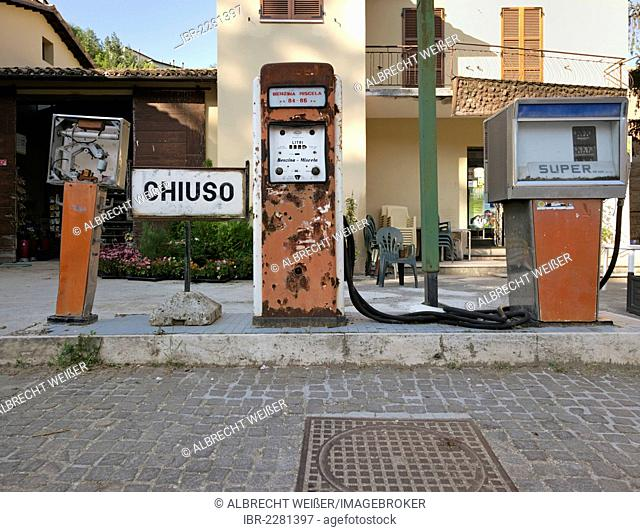 Old fuel pumps with rusty displays, abandoned petrol station in a rural area in Southern Italy, Italy, Europe