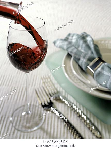 Pouring Red Wine into Glass, Place Setting