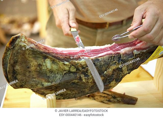 Slicing ham. Bioterra, fair of organic products, ecological management and the environment, FICOBA, Basque Coast International Fair