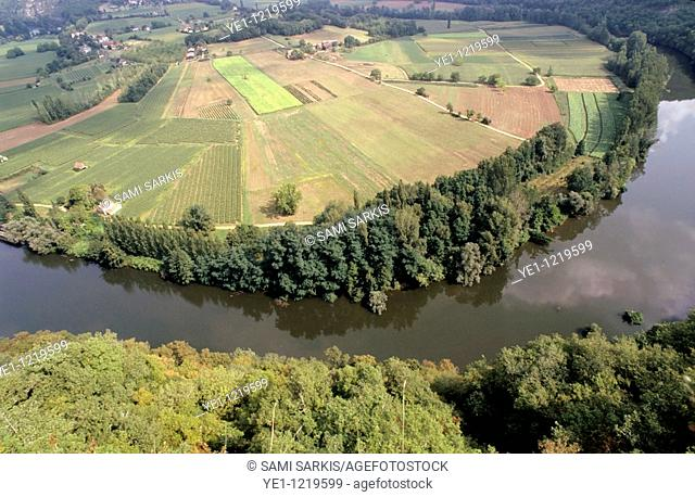 Lot Valley and Lot River surrounded by trees and farms seen from Saut de la Mounine, France