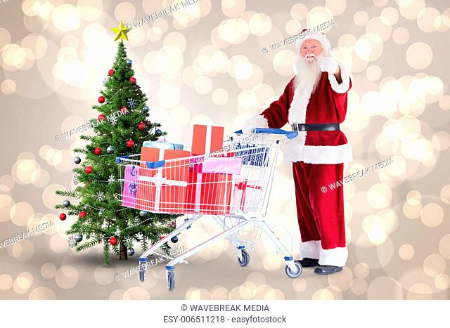 Composite image of santa pushing a shopping cart