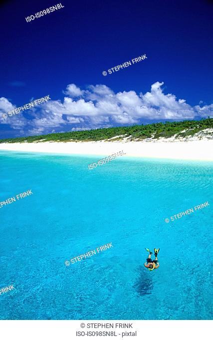 Snorkeler by remote island