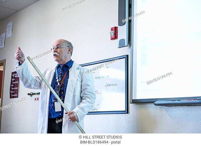 Teacher giving lecture in science classroom