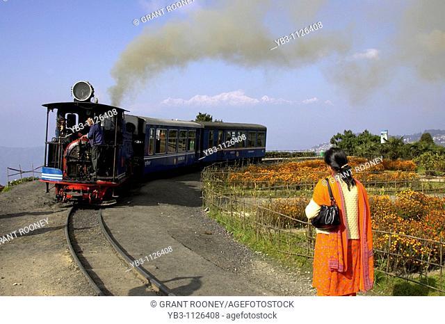 Woman waiting for the Darjeeling Himalayan Railway Toy Train, Darjeeling, West Bengal, India