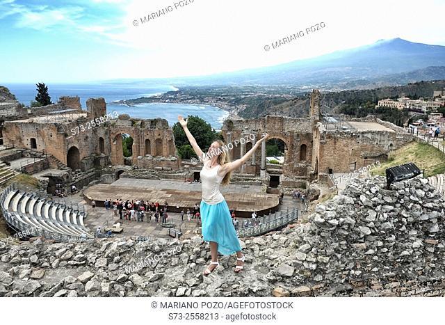 Woman at the Greek amphitheatre, Taormina, Sicily, Italy