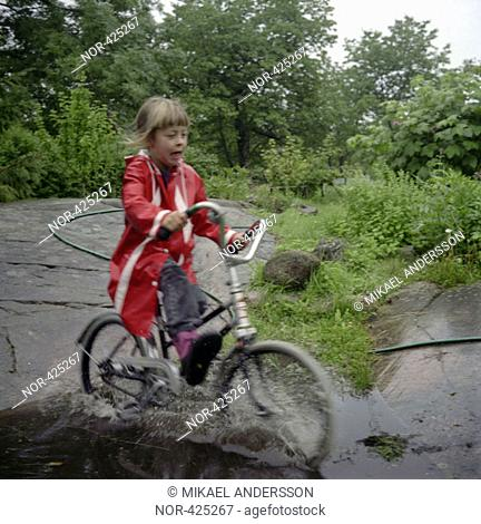 A girl bicycling in a brook  Sweden