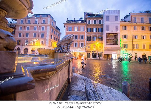 Trastevere district by dusk in Rome Italy on February 8, 2017 Fountain detail at St Mary square